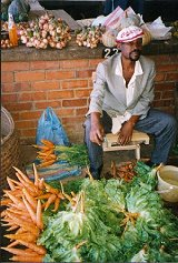 A vendor selling vegetables at Blantyre market